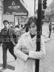 "Eighteen year old novelist Caroline Glyn standing outside French cafe satirized in her book ""Love and Joy in the Mabillon."""