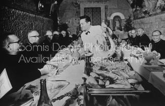 Group of bishops & priests attending 2nd Vatican Congress relaxing in restaurant.