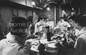 Maxim's subchefs enjoying meals identical to Paris restaurant's clientele.
