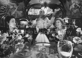 Maxim's Paris owner Louis Vaudable (C) and guests.