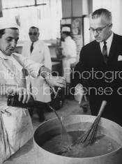 Maxim's Paris restaurant owner Louis Vaudable (R), inspecting factory kitchen.