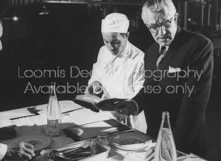 Maxim's head chef Alex Humbert (L) discussing menus with Maxim's Paris owner Louis Vaudable.