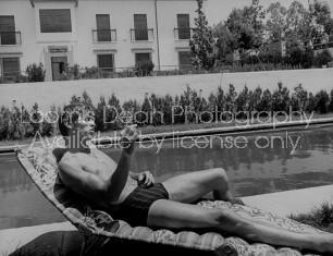 Spanish bullfighter Manuel Benitez aka El Cordobes, while relaxing by the pool.