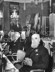 Millionaire author Nubar Gulbenkian (R) having lunch at the Dorchester Hotel.