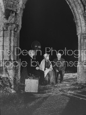 """Scene from NBC documentary on """"Stately Ghosts of England"""", starring British actress Margaret Rutherford (C) with husband Stringer Davis (R), and British clairvoyant Tom Corbett, at Salisbury Hall."""