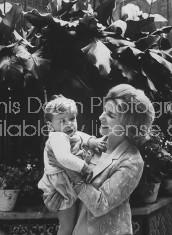 Duchess of Alba holding her youngest son, at her Seville palace.