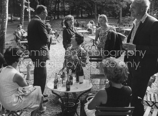 Poet Stephen Spender (R), Mrs. George Orwell (C, standing) and poet Robert Lowell (2L, standing) attending a picnic.
