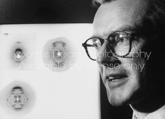 Dr. Maurice H. F. Wilkins looking at DNA x-ray negatives dealing with salt.