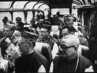 Bishops traveling by bus during visit to Rome for Ecumenical Council.