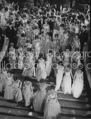 Debutantes descending grand staircase at Paris Operal Ball.