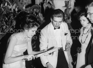 Daughter of conservative party chairman Iain Macleod,Diana Macleod (L), carving a roast pig for her guest during her coming out party.