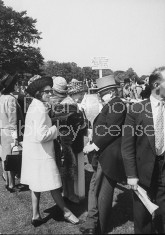 Daughter of conservative party chairman Iain Macleod,Diana Macleod (White Coat), and Lord and Lady Crathorne (2nd R), attending the Derby at Epson Downs.