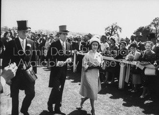 Antony Jones and his wife (C), attending the Derby at Epson Downs.
