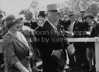 Queen Elizabeth (L) and the !6th Duke of Norfolk (C), attending the derby at Epson Downs.