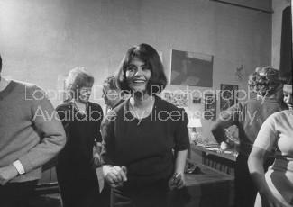 Actress Sophia Loren twisting at the Spaghetti party Life Magazine photographer Loomis Dean's Paris apartment..