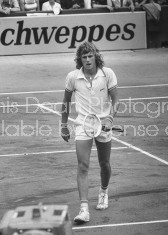 Tennis player Bjorn Borg sadly walking off the tennis court.