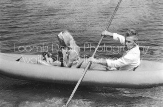 Conductor Herbert von Karajan (R) rowing an inflatable raft with wife Eliette and daughter Isabelle. [Scanned from contact sheet.]