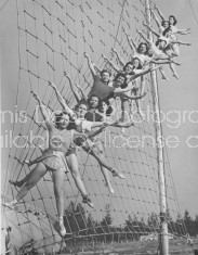 CIRCUS ACROBATS POSING ON A ROPE LADDER